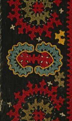 Coverlet of cotton embroidered with a circular center in a dense field within multiple borders. The so called Armenian embroideries are easi...