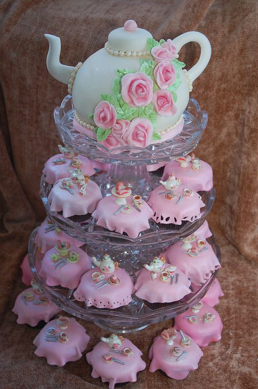 Tea Party Cake with tiny cupcakes, each one is a table with tea service on it! Cutest thing for a little girl's birthday tea party EVER :)