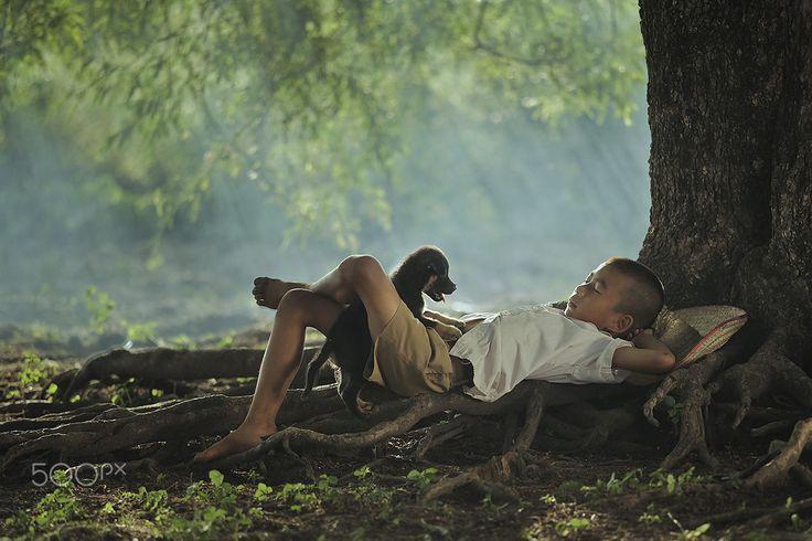 C a r e - the boy is sleeping under tree