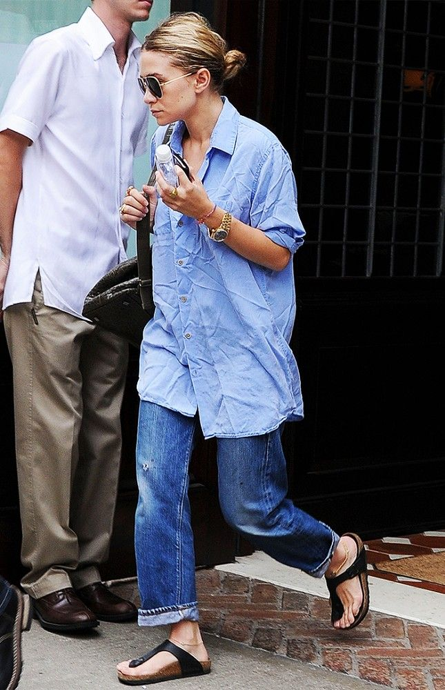 Ashley Olsen in an oversize button-down, gold watch, aviators, boyfriend jeans, and Birkenstock sandals | @andwhatelse