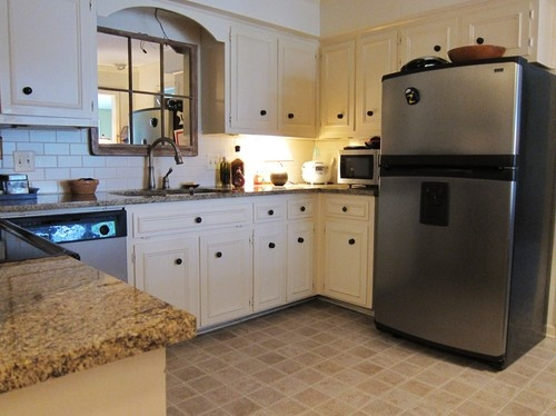 like the arch instead of the scallop over the sink - like that granite with white instead of the black