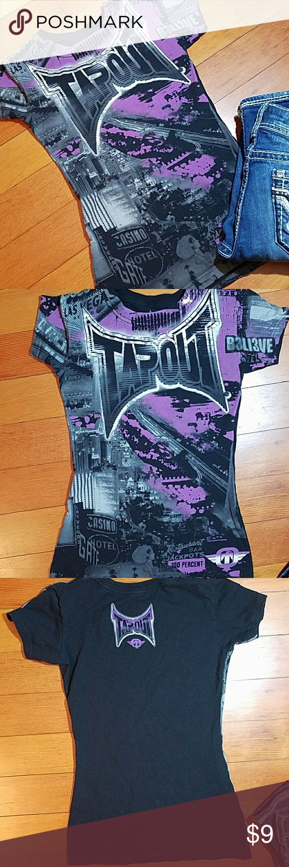 🌸5 for $25!🌸Tapout tee Tapout logo is metallic silver, purple designs throughout. Tag says small but this is an XXS/XS womens in my opinion. Tapout Tops Tees - Short Sleeve