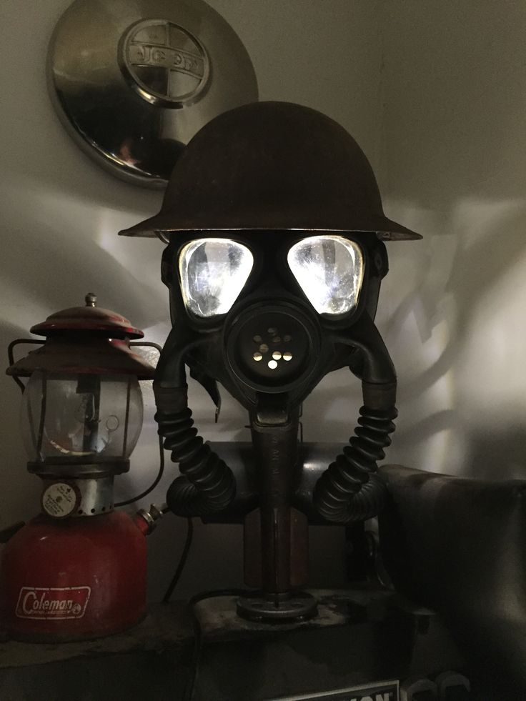 Gas Mask Lamp, made with a WW2 Navy gas mask, my great grandfathers WW1 helmet, some black pipe and imagination.