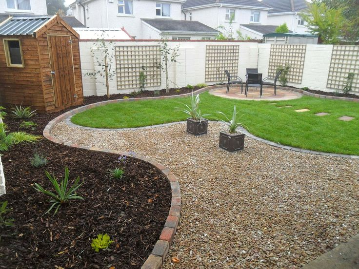 garden design makeover with a curving lawn and raised beds with a circular sandstone patio