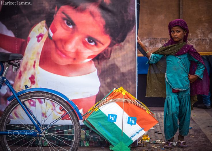 Kite seller - in this picture a girl trying to sell her kites on road.