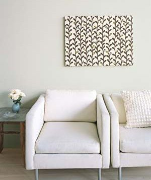 via real simple...5 DIY decorating projects like this framed art (w/fabric and a staple gun).