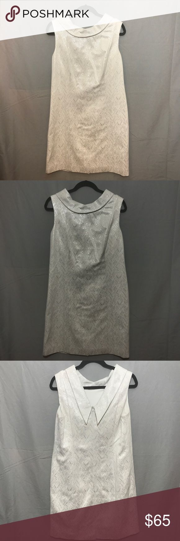 """Donna Ricco Dress This beautiful Donna Ricco Dress has never been worn and it's a very eye catching dress. This would be the perfect dress if you were going out on date, a wedding or any other special events. This dress is a nice cream warm color with a shining silver texture. (therefor it would look good at night to wear).   Shell = 36% Polyester, 52% Cotton & 12% Metallic Lining = 100% Polyester  Hollow to hem = 34"""" Shoulder = 15"""" Arm Circumference = 16"""" Bust = 38"""" Waist = 36"""" Hip = 38""""…"""