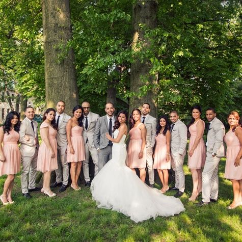 Light Pink and Grey Bridal Party I do not like the tea rose pink with the light grey tux's ... it looks wishy washy. The tux's need to be dark.