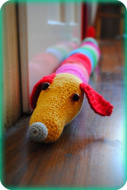 Inspiration: Dachshund draft excluder. Concept could be easily re-appropriated for 'baby boundaries' and pillows - make covers and wider door snakes etc animal forms to keep babies from rolling off the bed! :D