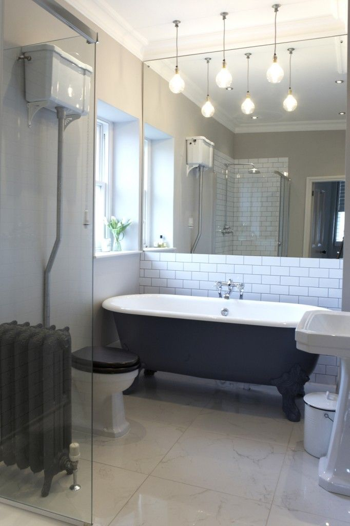 En-suite - métro tiles, roll top bath, matki shower, lefroy brooks taps, urban cottage industries lights, traditional style, Babington House style bathroom.