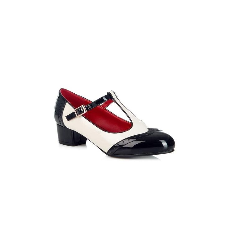 The Georgia Block Heel from Lulu Hun is a feminine take on a classic Spectator Shoe. She is made in matte PU, with contrasting coloured strap, ankle and heel area, and wingtips with broguing detail. She fastens with a gold metal buckle, with elastic for ease and comfort. Approximate Heel Height: 1.5 inches Fabrics: Upper: PU Insole: PU. Sole: Rubber
