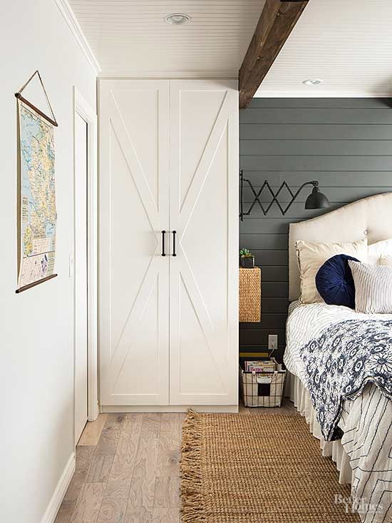 Wardrobes flanking the bed emulate the look of built-ins. Jenna dressed up doors of the plain IKEA units with strips cut from a plywood sheet applied in a crisscross pattern.