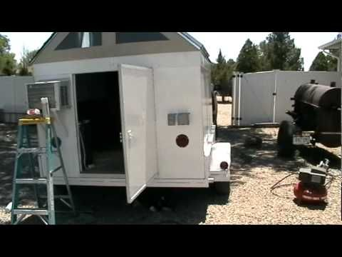 offgrid solar trailer.mpg - This guy is a huge dork, but his ideas are sound. I could see taking a second-hand doublewide and tarting it up into something solar powered and palatial. Or at least somewhere to live until the earthbag palace is finished.