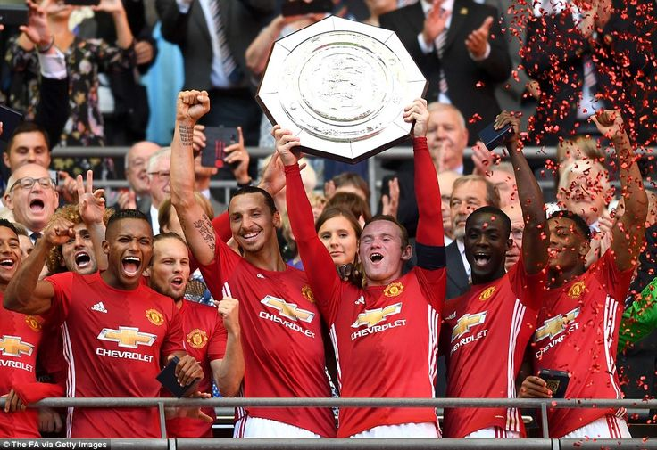 Manchester United's players celebrate with the Community Shield after beating Leicester 2-...