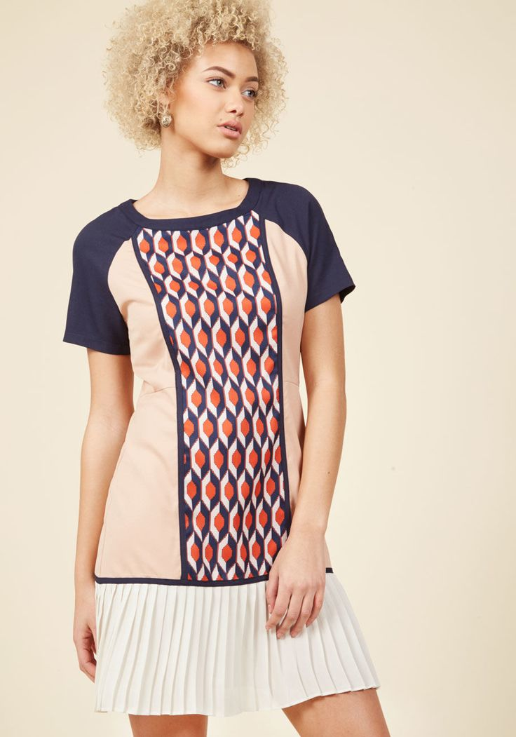 <p>Celebrate the iconic style of bygone times with a fresh twist by stepping out in this colorblock dress! Elevating the shift silhouette of this eye-catching number is a red-centered geometric pattern framed by beige sides, navy sleeves, and a pleated ivory hem - elements that past fashionistas would surely adore.</p>