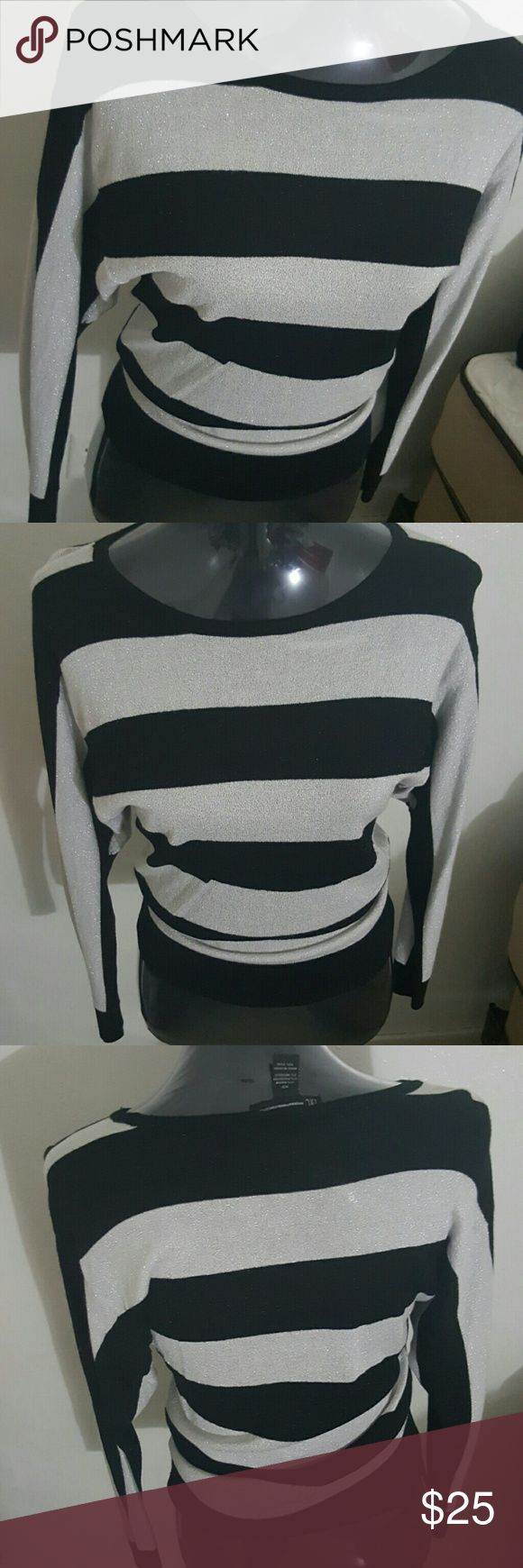 INC striped dolman top INC international concepts striped dolman. It's sparkly all over with black and silver. This is a regular xs and kinda sits off the shoulder for me. No stains or damages. Stock photo to show what it looks like on. Price negotiable in offers Macy's Tops Tees - Long Sleeve