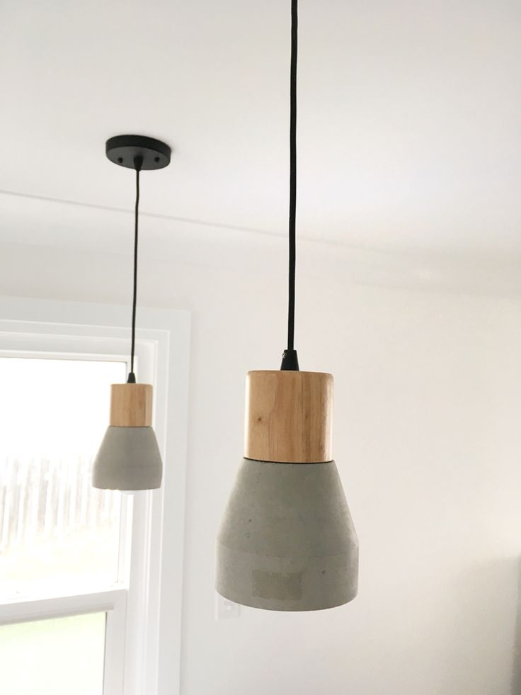 Concrete and natural wood pendant lights by Beldi