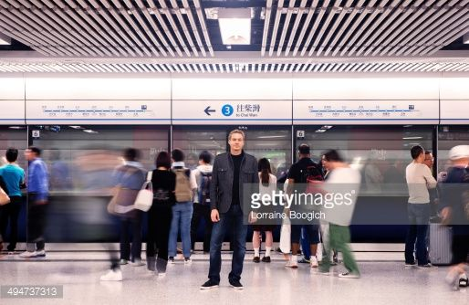 Stock Photo : Swiss Tourist Stands Out From Crowd in Hong Kong Subway