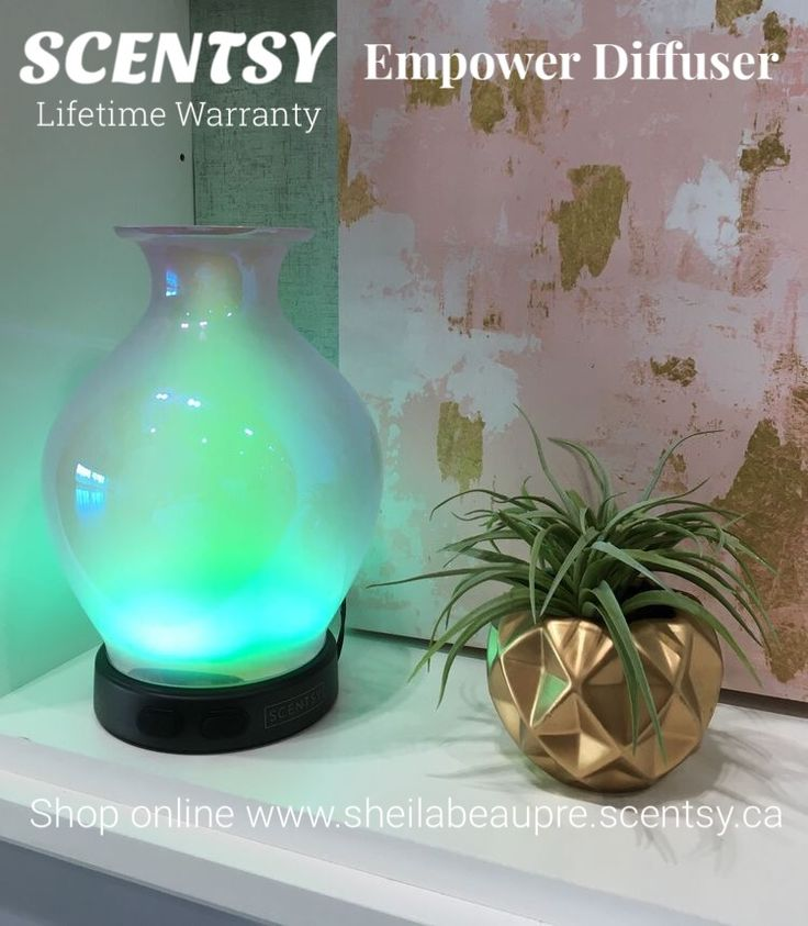 This elegant, iridescent vessel looks nearly as beautiful unlit as it does dancing with colour  and light.