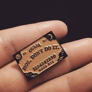 Hoe Don't Do It ouija board enamel pin