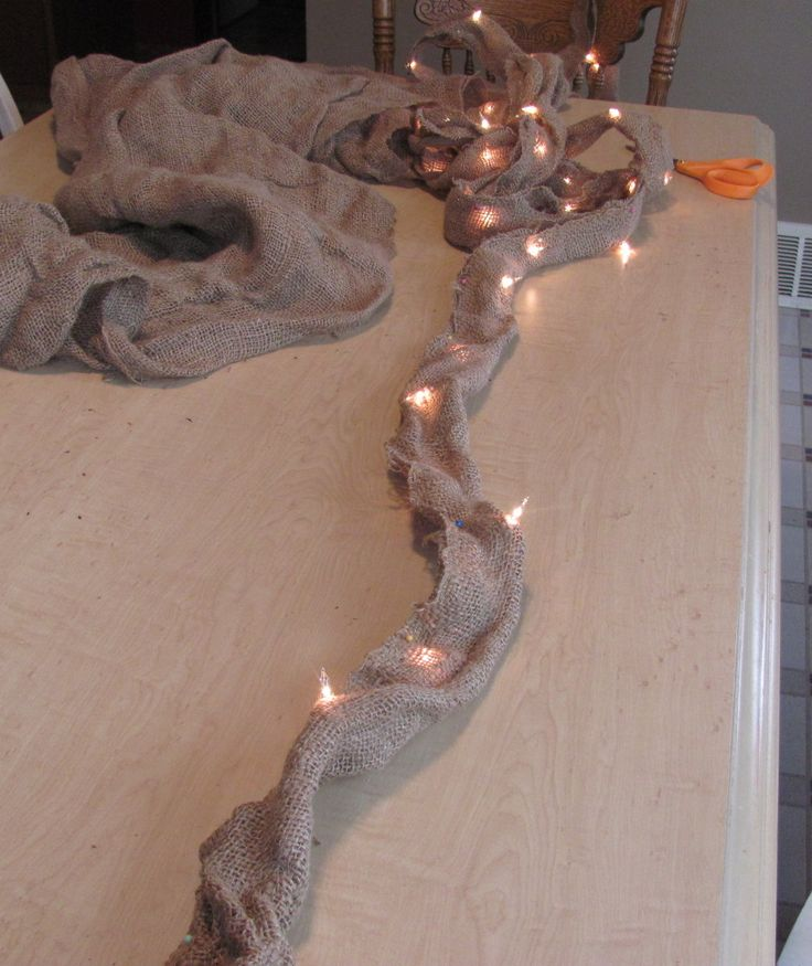 String Christmas lights in burlap. Rustic and fancy at the same time.