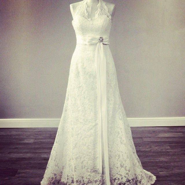 The Hayworth. A lovely lace halterneck dress with an elegant bow. http://www.viva-bride.com/gallery-vintage.html