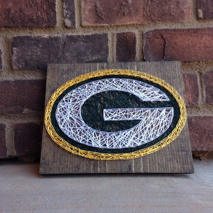 Green Bay packers string art home decor teachers gift football game day decoration Father's Day gift from my Etsy shop https://www.etsy.com/listing/293681693/green-bay-packers-string-art-stained