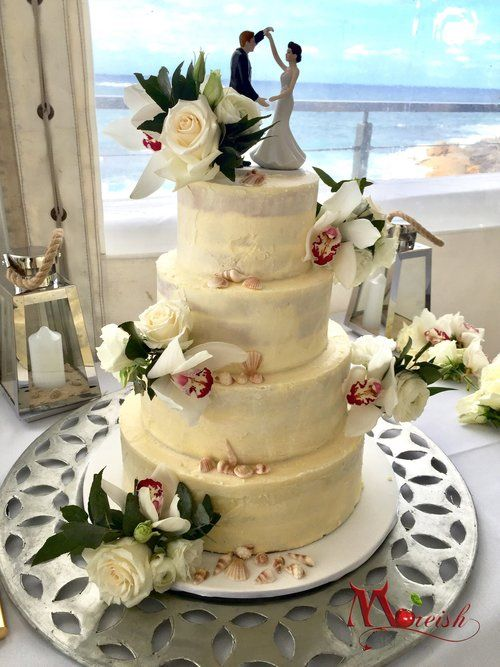 White Chocolate ganache semi naked cake with a beach theme for this ...