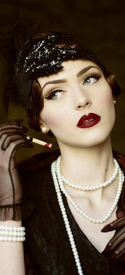 1920s- flawless skin, bronzed and dark blush used to pop the cheek bones pop. Beautiful ruby lip with a gloss. Winged liner with a dark crease to give the eye definition
