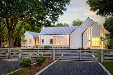 farmhouse exterior by Olsen Studios Like similar pattern of standing seam metal roof and smooh HardiePanels with fir battens.  The light colors of both integrate the surfaces.