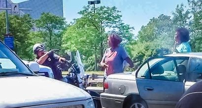 8/3/15 Cleveland police officer pulls weapon at scene of traffic accident. | A photo that went viral over the weekend showed an officer pulling his weapon on two black women who were at the scene of a hit and run, a spokesperson for the Cleveland Police Department explained on Monday.  A Sunday post on Reddit shared a photo from the Imgur service that had been viewed by nearly 2 million times by Monday afternoon. In it, an officer on a motorcycle can be seen ducking behind his vehicle and…