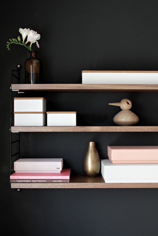 workspace/home office - black walls with timber shelves. Love the dark background contrast