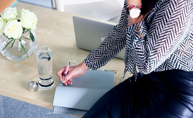 Taking notes with EQUA Drop key bottle.