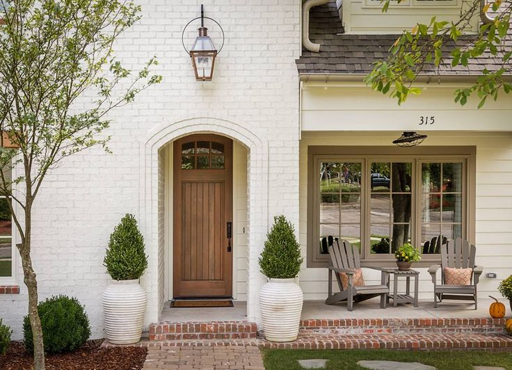 Happy Thanksgiving #Canada! I hope you're being able to count all of your #Blessings today!  Design by @willowhomesbham. #Photo by Tommy Daspit. #interiors #interiordesign #happythankgiving #CanadaThanksgiving #Fall #Pumpkins #Gratitude #porch #door #lighting #brick #paintedbrick