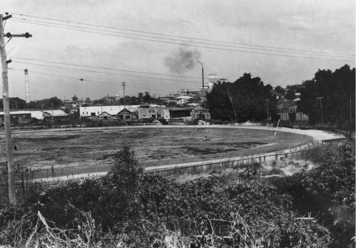 Lang Park sportsgrounds, Brisbane, Queensland, 1949 - This is Lang Park (now called Suncorp Stadium) as it looked back in 1949. You can see the smokestack of Castlemaine Perkins Brewery in the distance. The site was originally part of the North Brisbane Burial Ground between 1843 and 1875. It was estimated that approximately 5,000 bodies were buried there.