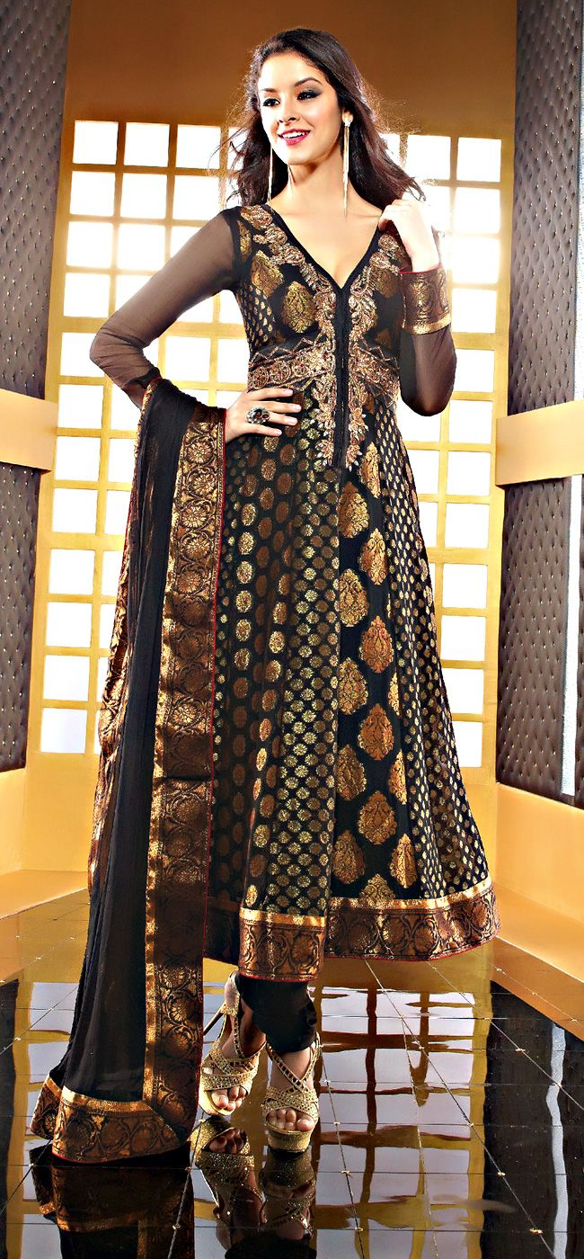 "Beautys Black Color Fauxchiffon Fabrics Anarkali Suit  ITEM CODE :- SLRC2113  PRICE:- 6255/- INR  Style: Anarkali Suit sleeve style: Sleeveless, Long Sleeve (18"" to 21"") size: 38"", 32"", 36"", 34"", 42"", 40"" occasion: Party, Festival, Reception fabric: Faux Chiffon color: Black Catalog No.: 1150 work: Embroidered, Resham , Zari  SHOP THIS SUIT FROM HERE http://www.vivaahsurat.com/salwar-kameez/beautys-black-color-fauxchiffon-fabrics-anarkali-suit-slrc2112"