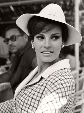 Raquel Welch at Cannes Film Festival in 1966.  Oh my goodness....Eva Mandes looks just like her!!