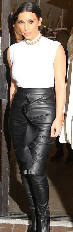 Kim Kardashian: Shirt – Lanvin  Leggings – Tamara Mellon  Shoes – Jacon Chain  Skirt – Givenchy
