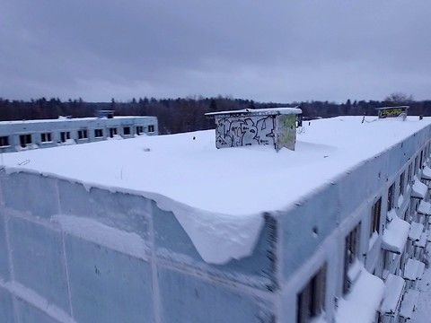 Drone shows a former military camp, located on the old Volokolamsk highway, 25 km from Volokolamsk, Russia. The town population serviced the anti-aircraft missile systems. There are two five-storey houses in a completely abandoned town, a multitude of administrative buildings, a guardhouse, a store and other ancillary facilities.