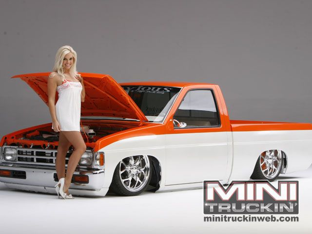 Mini Truckin Magazine model Kayla Collins and a lowered Nissan truck.