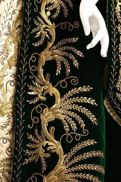 Russian court dress of a lady-in-waiting, c. 1900. An embroidered detail of the skirt. green velvet gold embroidery