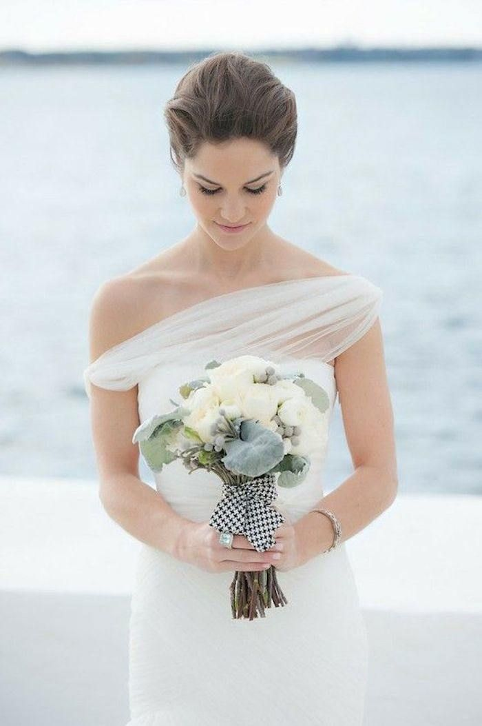 This unique neckline is perfect for the stylish, modern bride. How stunning. Photographer: Steve DePino via Houston Lifestyles