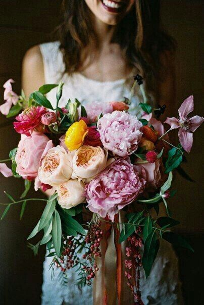 Crescent Bouquet Comprised Of: Large Pink Peonies, Pink Clematis, Fuchsia Ranunculus, Peach English Garden Roses, Yellow Ranunculus, Red Pepper Berries, Additional Coordinating Florals + A Variety Of Greenery/Foliage****