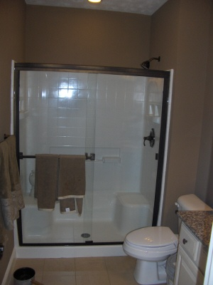 Could convert master tub/shower to just a shower enclosure similar to this one...
