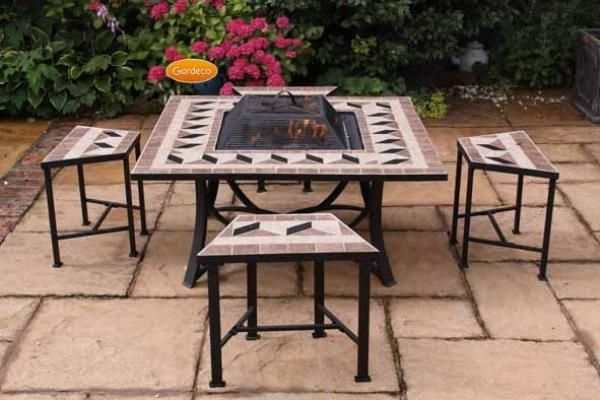 Firebowl table and chairs set.  Great for entertaining and display cooking!  Get your garden kitted out and ready for summer with our outdoor living range. We take a look at some of our favourite products to inspire in our latest blog post...  #outdoor #living #garden #decor #bbq #summer #lifestyle