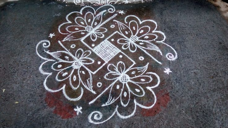 9 dots 3 lines end with 3 dots. Rev's kolam by revathiilango.