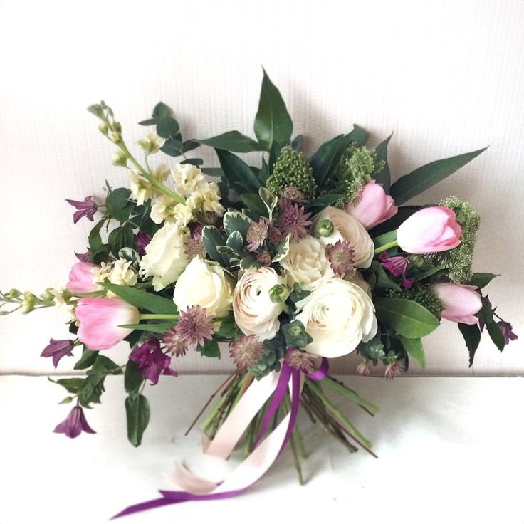 Nature inspired and soft pink bouquet: ranunculus, clematis, tulips