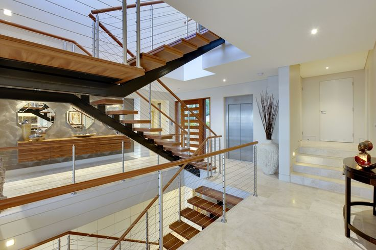 [Architectural staircase - Made by Genneral Staircase. Timber treads with open risers on metal monostring. Aluminium balusters with timber handrails.]    Tags: modern staircase | modern stairs | architectural stairs | contemporary staircase | contemporary stairs