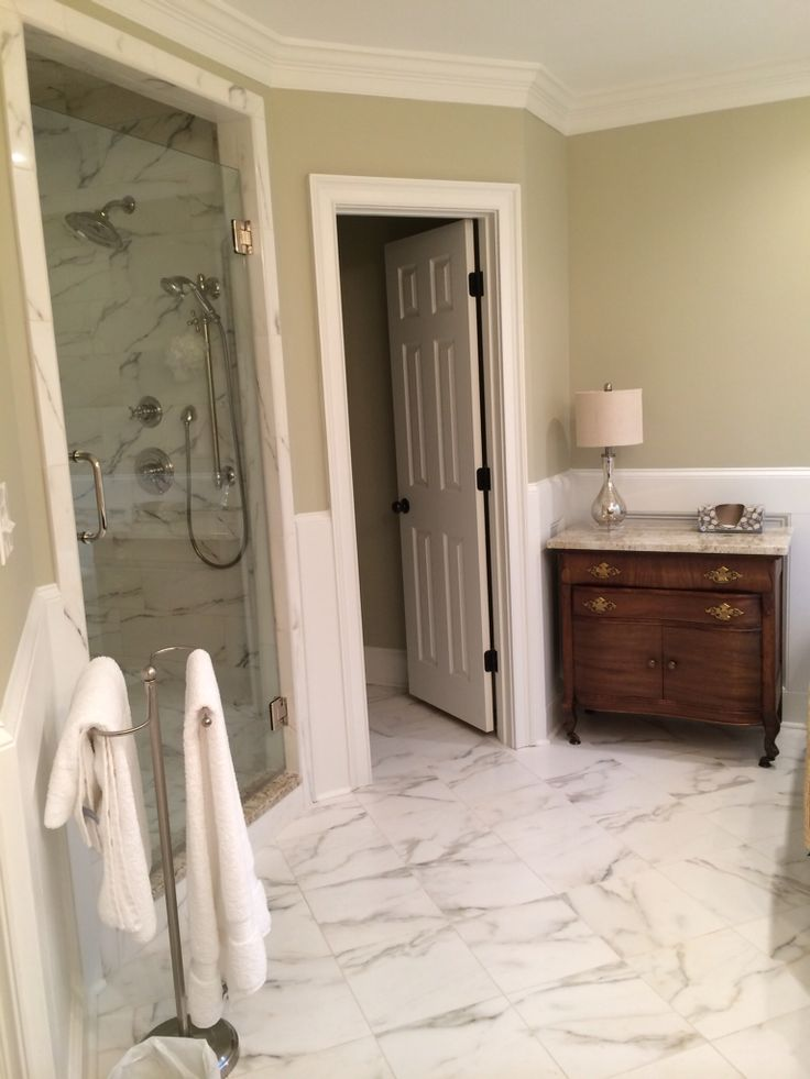 Naxos Marble Hill Sculptur tile, Benjamin Moore Camouflage paint, polished nickel fixtures.