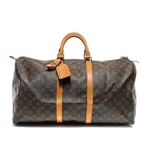 This is an authentic LOUIS VUITTON Vintage Monogram Keepall 55.   The traditional features and refined quality of this vintage Louis Vuitton luggage duffel bag are crafted of sturdy traditional Louis Vuitton monogram on toile canvas with vachetta cowhide leather straps and reinforced top handles with durable brass hardware.